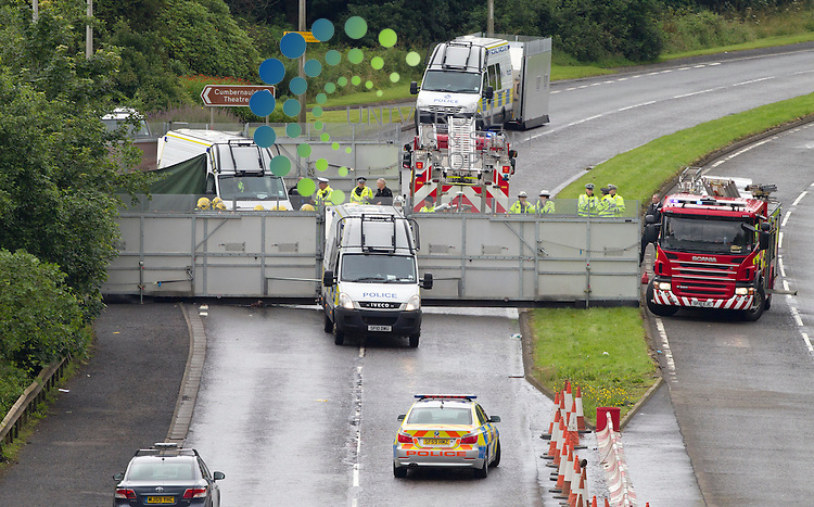 Three men have died and another man has been injured in a car crash in Cumbernauld, North Lanarkshire. The accident, involving three cars, happened at about 12:45 on the A8011 Central Way dual carriageway, known locally as Wilderness Brae. Three men died at the scene and the injured man has been taken to Monklands Hospital in Airdrie. <br /> The dual carraigeway is currently closed in both directions. Strathclyde Police said it was trying to establish the cause of the crash and the road would remain closed for some time. Insp Keith Prentice said: &quot;The A8011 is a very busy stretch of road in Cumbernauld which links the town to the M80, and at the time of the crash it would have been busy with vehicles. I would urge anyone who may have witnessed the crash and who may have information that can assist with our enquiries to get in touch.&quot;<br /> Picture: Maurice McDonald/Universal News And Sport (Europe). 1 August  2012. www.unpixs.com.