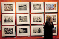Laura Lewkowicz looks at photographs from the Santa Monica-based Peter Fetterman Gallery during the opening night reception of the 20th Annual International Los Angeles Photographic Art Exposition and ArtLA Projects at the Santa Monica Civic Center on Thursday, January 13, 2010.