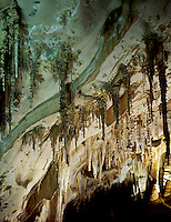STALACTITES &amp; STALAGMITES IN LIMESTONE CAVERN<br />
