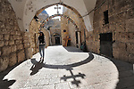A woman passes by the ninth station of Via Dolorosa, a street within Jerusalem's old city, which is believed to be the path that Jesus Christ walked carrying his cross, on his way to crucifixion.<br /> <br /> Via Dolorosa is marked by 14 stations; the ninth station is held by popular tradition to be the location where Jesus stumbled for the third time during his walk along the route.