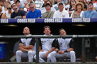 10 August 08: Colorado Rockies players, from left, outfielder Matt Holliday, 1st baseman Garrett Atkins, and shortstop Troy Tulowitzki watch a pop fly from the Rockies dugout during a game against the San Diego Padres. The Padres defeated the Rockies 16-7 at Coors Field in Denver, Colorado. FOR EDITORIAL USE ONLY. FOR EDITORIAL USE ONLY