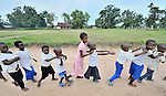 Children in elementary school sponsored by the United Methodist Church in the Congolese village of Wembo Nyama walk to an activity.
