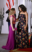 First Lady Michelle Obama, right, greets Mrs. Sophie Gr&eacute;goire Trudeau, left, of Canada on the North Portico of the White House March 10, 2016 in Washington,D.C. <br /> Credit: Olivier Douliery / Pool via CNP