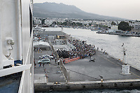 Crowd of refugees wait to board a docked ferry. From Athens they will try to reach Germany via  Macedonia, Serbia and Hungary. Kos, Greece. Sept.7, 2015