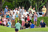 Kailua, Hawaii - December 24, 2008 -- United States President-elect Barack Obama acknowledges people watching him as he walks to his motorcade to leave Mid-Pacific Country Club in Kailua, Hawaii on Wednesday, December 24, 2008..Credit: Joaquin Siopack / Pool via CNP