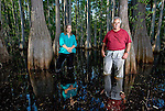 Anne and Jack Rudloe stand in the dark tannic waters of a cypress swamp on their property in Panacea, Florida May 10, 2009