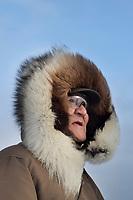 Native Alaskan Inupiat man portrait with wolverine fur ruff parka, Kaktovik, Alaska.