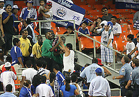 Fan of El Salvador tussles with guards during an international charity match against D.C. United at RFK Stadium, on June 19 2010 in Washington DC. D.C. United won 1-0.