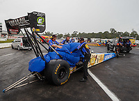 Aug 20, 2016; Brainerd, MN, USA; Crew members use a rain cover to cover the engine on the dragster of NHRA top fuel driver Morgan Lucas during a rain delay to qualifying for the Lucas Oil Nationals at Brainerd International Raceway. Mandatory Credit: Mark J. Rebilas-USA TODAY Sports