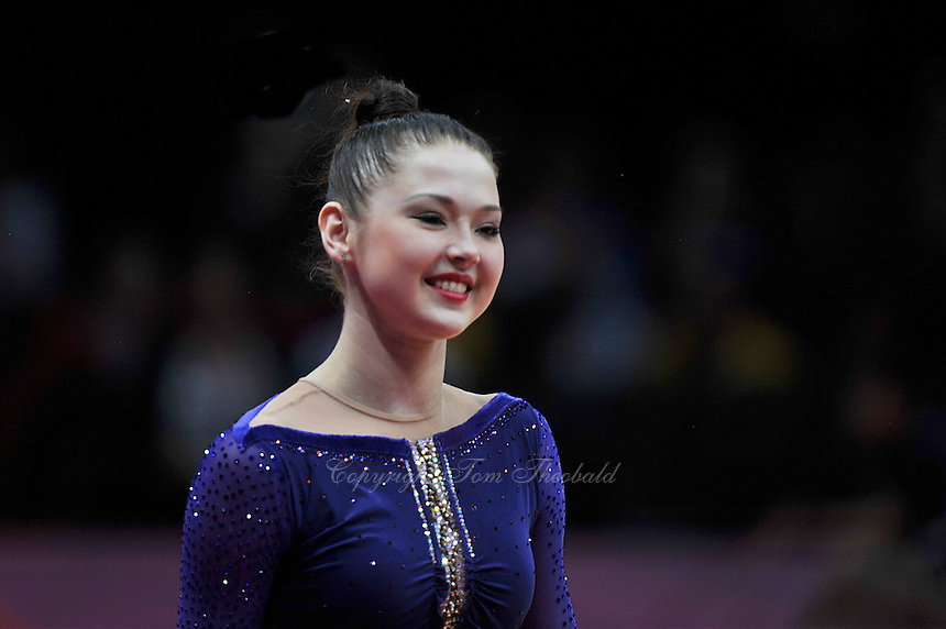 August 9, 2012; London, Great Britain; ALINA MAKSYMENKO of Ukraine smiles to fans during march-out after day 1 of rhythmic gymnastics qualifications at 2012 London Olympics. .