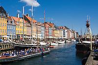 Tour boat on Nyhavn or New Harbor canal in Copenhagen, Denmark.