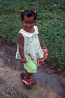 Coy young black girl in the town of Bocas del Toro, Isla Colon, Panama