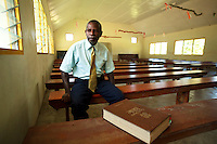 Church elder Ayar, also a prominent chief in South West Bay, Malekula, Vanuatu sitting in an empty church.
