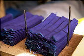 SULAIMANIYAH, IRAQ: Folded blue fabric used to make the sole of klash. ..Klash are traditional hand made Kurdish shoes. Klash were originally made by members of the gypsy Dom tribe but are now made by numbers of different Kurds in the Hawraman region along the Iraq/Iran border...Photo by Besaran Tofiq/Metrography