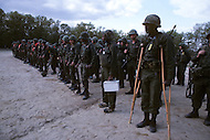 Fort Dix, NJ, USA, June 1980. Male and female recruits standing in line during an assembly. Lightly injured soldiers are required to participate.