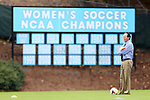17 October 2013: UNC head coach Anson Dorrance in front of the sign commemorating his team's 22 national championships. The University of North Carolina Tar Heels hosted the Syracuse University Orangemen at Fetzer Field in Chapel Hill, NC in a 2013 NCAA Division I Women's Soccer match. UNC won the game 1-0.