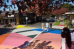 "Pedestrians pass over Jessica Stockholder's ""Cross Hatch installation as they cross State Street in Los Altos."