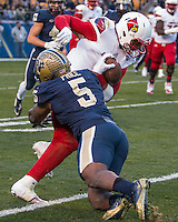 Pitt defensive end Ejuan Price (5) makes a tackle. The Pitt Panthers football team defeated the Louisville Cardinals 45-34 on Saturday, November 21, 2015 at Heinz Field, Pittsburgh, Pennsylvania.