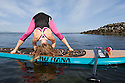 PE00300-00...WASHINGTON - Carly Hayden doing paddle board yoga in the Puget Sound at Brackett's Landing North, Edmonds.  (MR #H13)