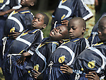 Children displaced by war in the eastern Congo prepare for a soccer game. They live in a displaced persons camp in the village of Sasha. A quarter of a million people have been newly displaced by fighting in the eastern Congo, where some 5.4 million have died since 1998 from war-related violence, hunger and disease.