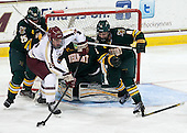 Nick Luukko (UVM - 25), Bill Arnold (BC - 24), Nick Bruneteau (UVM - 4) - The Boston College Eagles defeated the University of Vermont Catamounts 4-1 on Friday, February 1, 2013, at Kelley Rink in Conte Forum in Chestnut Hill, Massachusetts.