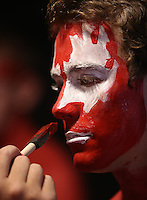 Trevor McCue, a junior at Ohio State University, gets his face painted below the student section before Saturday's NCAA Division I football game against Wisconsin at Ohio Stadium in Columbus on September 28, 2013. (Barbara J. Perenic/Columbus Dispatch)