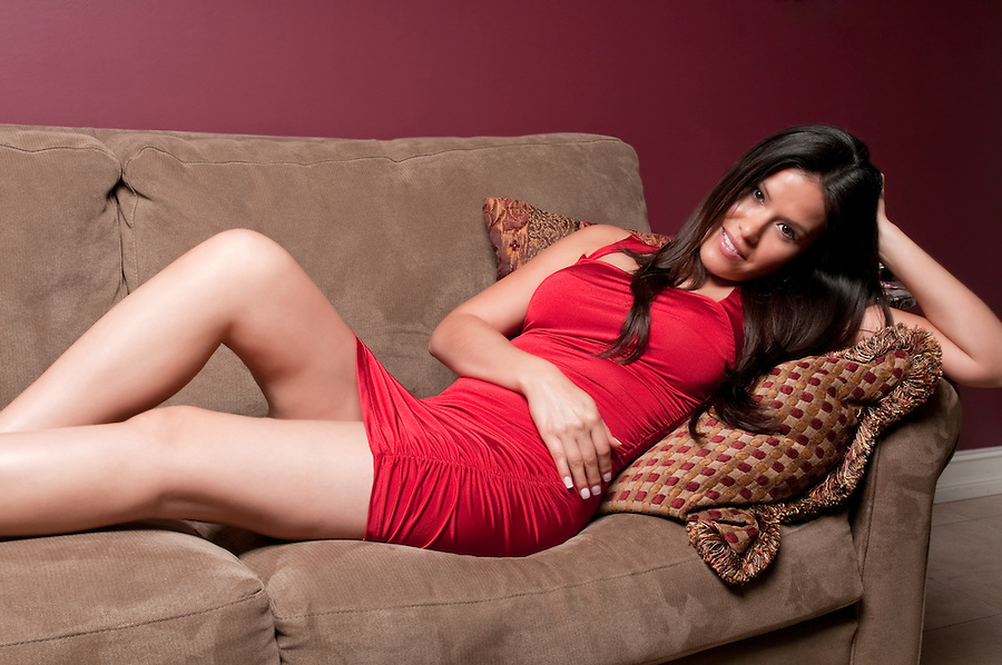 Young hispanic girl resting in very comfortable sofa.