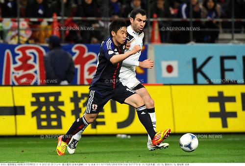 Shinji Kagawa (JPN), Timur Kapadze (UZB),.FEBRUARY 29, 2012 - Football / Soccer :.2014 FIFA World Cup Asian Qualifiers Third round Group C match between Japan 0-1 Uzbekistan at Toyota Stadium in Aichi, Japan. (Photo by Takamoto Tokuhara/AFLO)