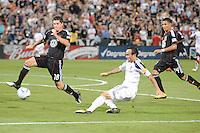 LA Galaxy midfielder Landon Donovan (10) makes a pass while cover by DC United defender Devon McTavish (18). LA Galaxy defeated DC United 2-1 at RFK Stadium, Saturday July 18, 2010.