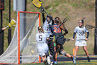 Towson, MD - March 5, 2017: Towson Tigers Angie Benson (77) tries to save the shot by Florida Gators Brianna Harris (20) during game between Towson and Florida at  Minnegan Field at Johnny Unitas Stadium  in Towson, MD. March 5, 2017.  (Photo by Elliott Brown/Media Images International)