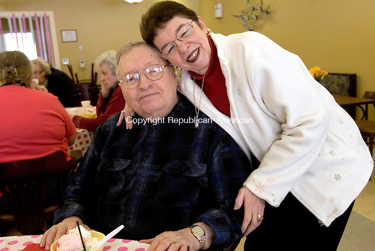 WOODBURY CT. 10 February 2014-021014SV06-Sharon Sherman of Woodbury gives her sweetheart Norman Sherman a hug during the Sweetheart Ice Cream Social at the senior center in Woodbury Monday. The seniors enjoyed the ice cream to the sounds of the cello played by Thirzah Bendokas of Naugatuck.<br /> Steven Valenti Republican-American