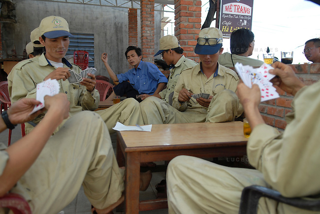 Vietnamese workers take a lunch break and play cards in Hoi An, Vietnam.