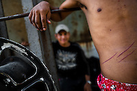"A young immigrant, wounded by a fall of the train, stands on a wagon of the cargo train called 'La Bestia' (The Beast) on a train station in a border town of Arriaga, Mexico, 25 May 2010. Between 2010 and 2015, the US and Mexico have apprehended almost 1 million illegal immigrants from El Salvador, Honduras, and Guatemala. While the economic reasons remain the most frequent motivation for people from Central America to illegally immigrate to the US, thousands of Salvadorans, Guatemalans, and Hondurans, many of them minors, seek asylum in the US due to the thriving crime and gang-related violence in their region (known as the Northern Triangle). Taking an exhausting and risky journey, riding thousands of miles atop the cargo trains, facing a physical danger and extortion from the organized crime groups that control migrant routes, the ""undocumented"" still flee to the US, looking for their American dream."
