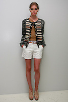Model poses in an M. Patmos Pre-Spring 2012 collection outfit by Marcia Patmos, during the M. Patmos Pre-Spring 2012 preview, June 15th 2011.