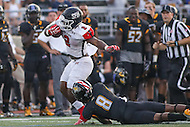 Towson, MD - September 9, 2016: St. Francis (Pa) Red Flash running back Marcus Bagley (2) is tackled by Towson Tigers defensive back Monty Fenner (8) during game between Towson and St. Francis at  Minnegan Field at Johnny Unitas Stadium  in Towson, MD. September 9, 2016.  (Photo by Elliott Brown/Media Images International)
