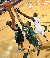 Dec. 20, 2010; Charlottesville, VA, USA; Norfolk State Spartans forward Kyle O'Quinn (10) grabs a rebound in front of Norfolk State Spartans guard/forward Rodney McCauley (15) and Virginia Cavaliers center Assane Sene (5) during the game at the John Paul Jones Arena. Virginia won 50-49. Mandatory Credit: Andrew Shurtleff