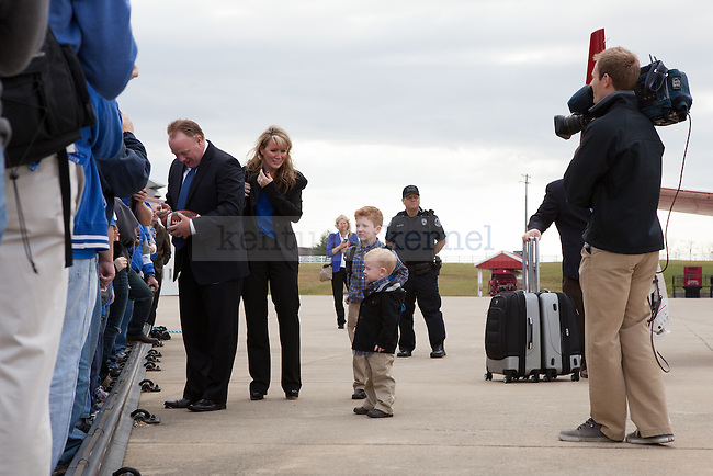 New University of Kentucky head football coach Mark Stoops and family at the R.J. Corman Hanger in Nicholasville, Ky on December 2, 2012. Photo by Adam Chaffins   Staff