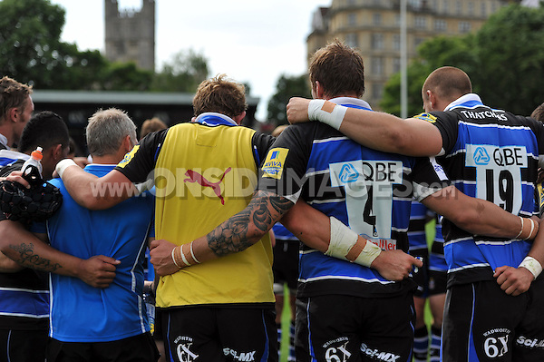 The Bath squad huddle together prior to the second half. Pre-season friendly match, between Bath Rugby and London Welsh on August 11, 2012 at the Recreation Ground in Bath, England. Photo by: Patrick Khachfe / Onside Images