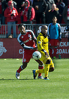 31 March 2011: Columbus Crew forward Emilio Renteria #20 and Toronto FC midfielder Julian de Guzman #6 in action during a game between the Columbus Crew and the Toronto FC at BMO Field in Toronto, Ontario Canada..The Columbus Crew won 1-0.