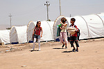 DOMIZ, IRAQ: Children walk through the Domiz refugee camp...Over 7,000 Syrian Kurds have fled the violence in Syria and are living in the Domiz refugee camp in the semi-autonomous region of Iraqi Kurdistan...Photo by Ari Jalal/Metrography