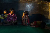 Children during class in the Guria Non-Formal Education center in the middle of the Shivdaspur red light district, Varanasi, Uttar Pradesh, India on 11 November 2013. Women in Prostitution working and living in the Shivdaspur red light area send their children to the centre run by Guria in hope that their children will get a better education and break the cycle of generational prostitution and trafficking.