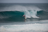 PIPELINE, Oahu, Hawaii (Sunday, December 8, 2013) Bede Durbidge (AUS) and matt Wilkinson (AUS) split the peak. - The opening day of the Billabong Pipe Masters, in Memory of Andy Irons, commenced today in firing six-to-eight foot (2 metre) waves and the world's best surfers put on an incredible display of technical barrel riding at Pipeline and Backdoor to complete Rounds 1 and 2. The Billabong Pipe Masters is the third and final leg of the Vans Triple Crown of Surfing.<br /> <br /> The final stop on the ASP World Championship Tour (WCT), the Billabong Pipe Masters will decide the 2013 ASP World Title Race, the coveted Vans Triple Crown of Surfing Champion and the final qualification slots for next season's Top 34. <br /> Gabriel Medina (BRA), 19, would put together an amazing show at the iconic lefts of Pipeline to kick off the Billabong Pipe Masters, navigating through a heavy barrel on his opening score to post a near-perfect 9.67. The Brazilian Prodigy would quickly back up the ride, earning an additional 9 point score for another deep Pipe tube punctuated with a massive alley-oop, eliminating Bruce Irons (HAW), 34. Medina's unlikely aerial at Pipeline puts him in the running for a 250,000 mile prize from   Hawaiian Airlines Airshow award.<br /> Sebastian Zietz (HAW), 25, defending Vans Triple Crown of Surfing Champion, immediately found his rhythm at Pipeline, earning the first perfect 10-point ride of Billabong Pipe Masters competition for an unbelievable Backdoor barrel.<br /> Photo: joliphotos.com