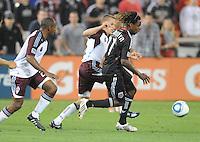DC United forward Joseph Ngwenya (11) runs with the ball follow by Colorado Rapids midfielder Wells Thompson (15)   DC United tied The Colorado Rapids 1-1, at RFK Stadium, Saturday  May 14, 2011.