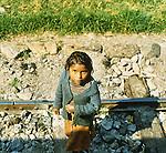 Peru Beggar Girl on Railroad tracks