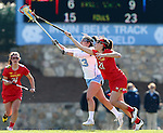 27 February 2016: Maryland's Taylor Cummings (21) and North Carolina's Sammy Jo Tracy (13) challenge for a draw. The University of North Carolina Tar Heels hosted the University of Maryland Terrapins in a 2016 NCAA Division I Women's Lacrosse match. Maryland won the game 8-7.