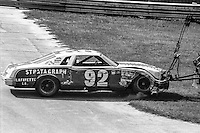 Skip Manning, #92 Buick, is towed away after crashing en route to 39th place finish, 1978 Firecracker 400 NASCAR race, Daytona International Speedway, Daytona Beach, FL, July 4, 1978.  (Photo by Brian Cleary/ www.bcpix.com )