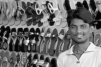 A happy shopkeeper in central Mumbai, selling women shoes, Mumbai, India