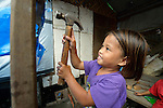 Princess Angel Moristo, 7, helps build a temporary shelter for her family in Tacloban, a city in the Philippines province of Leyte that was hit hard by Typhoon Haiyan in November 2013. The storm was known locally as Yolanda. The ACT Alliance has been active here and in affected communities throughout the region helping survivors to rebuild their homes and recover their livelihoods.
