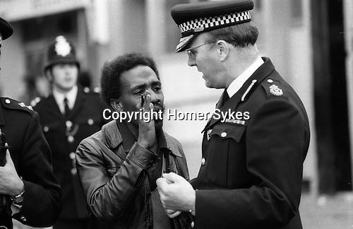 Nottinghill Gate Carnival race riot, London W11 England 1976. Police informer.