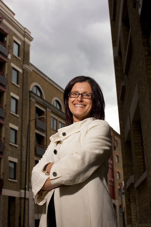 Alexandra Kelly, Director of Powerchex ( pre-employment screening for financial institutions ) photographed near and in her offices in Wapping, east London, UK